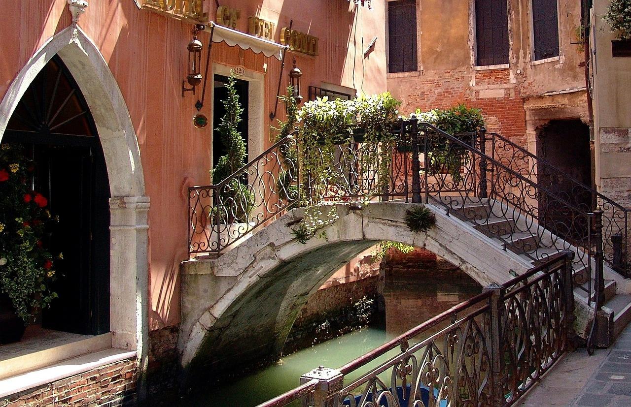 About Plaster Artistry - romantic bridge over Venetian canal.